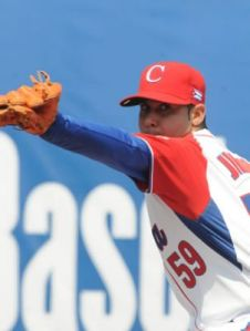 Ismel Jimenez proves solid as Cuba's opening game starter.